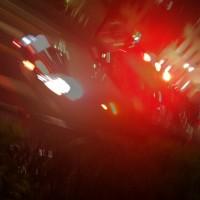 明治通りを巡回するパトカー